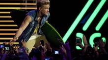 Cody Simpson on stage in Toronto: The 16-year-old Australian is sweeter, bigger, faster, stronger, younger, blonder than Justin Bieber. (Aaron Vincent Elkaim/The Canadian Press)