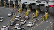Vehicles stop at customs booths while entering the United States from the tunnel coming under the Detroit river from Windsor, Ontario in downtown Detroit, Michigan March 1, 2013. (REBECCA COOK/REUTERS)