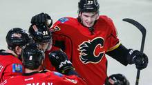 Nov 27, 2013; Calgary, Alberta, CAN; Calgary Flames center Sean Monahan (23) celebrates his goal with teammates against the Chicago Blackhawks during the third period at Scotiabank Saddledome. (Sergei Belski/USA Today Sports)