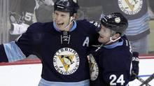 Pittsburgh Penguins' Jordan Staal, left, celebrates his goal with Matt Cooke (24) during the third period of an NHL hockey game against the Winnipeg Jets in Pittsburgh, Saturday, Feb. 11, 2012. (Gene J. Puskar/AP)