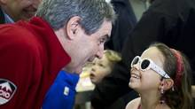 A young girl shows off her sunglasses to Liberal Leader Michael Ignatieff at a market Saturday, April 30, 2011 in Guelph, Ont. (Paul Chiasson/THE CANADIAN PRESS)