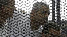 Peter Greste, Mohamed Fahmy and Baher Mohamed (left to right) listen to a ruling at a court in Cairo June 23, 2014. (ASMAA WAGUIH/REUTERS)