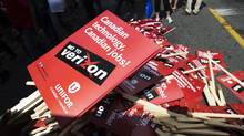A pile of signs is pictured after a rally held by the new Unifor union to protest against the possible entry of U.S. telecom Verizon into the Canadian wireless market, in Toronto, Aug. 30, 2013. Consumers have a last-resort ally in the CRTC under the leadership of Jean-Pierre Blais. (MARK BLINCH/REUTERS)