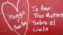 This Jan. 15, 2013 photo shows Spanish graffiti left by a worker on a steel column on the 104th floor. The phrase means, 'I love you three steps above heaven.' (Mark Lennihan/AP)