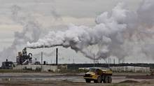A dump truck works near the Syncrude oil sands extraction facility near the town of Fort McMurray, Alberta on Sunday June 1, 2014. The conference, As Long as the Rivers Flow: Coming Back to the Treaty Relationship in Our Time, is taking place in Fort McMurray over the weekend. THE CANADIAN PRESS/Jason Franson The tens of billions of dollars of cancelled investment in oil sands projects profoundly changes the national debate Canadians have been having about the supposedly urgent economic need for new pipelines. (JASON FRANSON/THE CANADIAN PRESS)