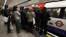 Travellers queue as the doors close on a packed rush hour tube train in central London in this file photo. (Andrew Winning/Reuters)