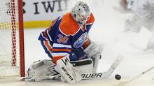 Edmonton Oilers goalie Ben Scrivens stops a shot during the third period against the San Jose Sharks at Rexall Place. (USA TODAY Sports)