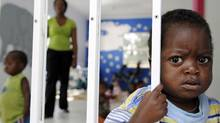 A child looks out from the play room at a shelter for destitute HIV-infected mothers in Johannesburg on Nov. 25, 2009. (STEPHANE DE SAKUTIN/AFP/Getty Images)