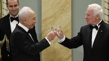 Israel's President Shimon Peres (L) toasts with Canada's Governor General David Johnston during a state dinner at Rideau Hall in Ottawa. (Chris Wattie/Reuters)