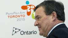 Federal Finance Minister Jim Flaherty arrives for an update news conference regarding the 2015 Pan Am Games in Toronto on Friday. (Frank Gunn/The Canadian Press)