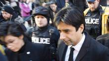 Jian Ghomeshi leaves a Toronto courthouse after the first day of his trial on Feb. 1. (Frank Gunn/AP Photo)