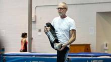 Tim McCaskell, 62, practices tai chi at the University of Toronto Athletic Centre in Toronto as part of a healthy lifestyle he credits with enabling him to age well while living with HIV, Tuesday, Dec. 3, 2013. (Galit Rodan for The Globe and Mail)