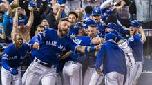 Toronto Blue Jays players celebrate their walk-off win to eliminate the Texas Rangers during the tenth inning to win the American League Division Series in Toronto on Sunday, October 9, 2016. (Mark Blinch/THE CANADIAN PRESS)
