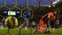 Chelsea's Fernando Torres shoots to score a penalty against Sunderland during their English Premier League match in Sunderland, northern England December 8, 2012. (NIGEL RODDIS/REUTERS)