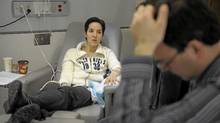 Dan Anzarut, right, sits near his wife Jill who will be undergoing the start of her chemotherapy program at Princess margaret Hospital on March 9, 2011. She's unable to receive the cancer-fighting drug Herceptin because her tumour is too small. She will have to pay for it out of her own pocket but she plans to fight this. (Fred Lum/The Globe and Mail/Fred Lum/The Globe and Mail)