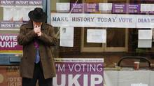 A man lights a cigarette outside the UKIP (UK Independence Party) offices in Eastleigh, southern England February 28, 2013. Voters in Eastleigh voted for a new MP on Thursday, following the resignation of Lib Dem politician Chris Huhne. (LUKE MACGREGOR/Reuters)