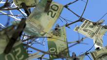 Canadian and U.S. banknotes are seen in this file photo. (Maciej Korzekwa/Getty Images/iStockphoto)