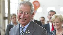 Prince Charles reactes after being aced while playing badminton while touring the future site Pan/Parapan American Games Athlete's Village in Toronto on Tuesday, May 22, 2012. The royal couple are on a four-day visit to Canada to mark the Queen's Diamond Jubilee. (Paul Chiasson/THE CANADIAN PRESS)
