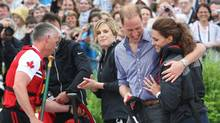 The Duke and Duchess of Cambridge hug after taking part in a dragon boat race in Dalvay Lake, P.E.I. Monday, July 4, 2011. (Ryan Remiorz/THE CANADIAN PRESS/Ryan Remiorz)