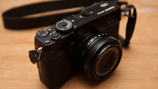 The X-Pro1 is Fuji's succesor to the X100, a diminuitive, fixed-lens compact camera with a retro-inspired design. Both cameras sport a faux-leather body, and from afar could easily be mistaken for high-end Leicas. It's clear that Fuji has again taken the time to make the X-Pro1 look good. (Matthew Braga/The Globe and Mail)