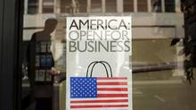 A sign is shown in the window of a retail store in San Francisco, Calif. in this file photo taken May 13, 2013. (ROBERT GALBRAITH/REUTERS)