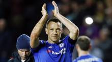Chelsea's John Terry applauds the fans after a 5-1 win over Milton Keynes Dons in the fourth round of the FA Cup on Jan. 31. Chelsea will play host to Manchester City in the round of 16. (Darren Staples/REUTERS)