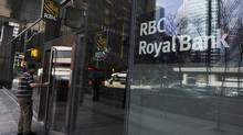A man walks into a Royal Bank of Canada (RBC) in Toronto March 3, 2011. Royal Bank of Canada (RY.TO: Quote) said on Thursday that quarterly earnings rose 23 percent, driven by retail loan growth and lower provisions for bad loans REUTERS/Mark Blinch (CANADA - Tags: BUSINESS) (MARK BLINCH/REUTERS)