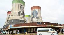 Giant portraits of former African National Congress (ANC) presidents, including former South African President Nelson Mandela, right, overlook Bloemfontein, South Africa, Thursday, Dec 13, 2012. (John Dube/The Associated Press)