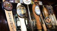 Beer tap handles show a variety of names at the Horsebrass Pub in Portland, Ore., Thursday, July, 2008. (Don Ryan/AP)