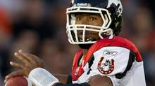 The Calgary Stampeders have traded quarterback Henry Burris to the Hamilton Tiger-Cats according to reports. THE CANADIAN PRESS/Darryl Dyck (Darryl Dyck/CP)