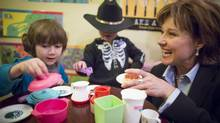 Liberal Leader Christy Clark takes time out from the big picture Wednesday to enjoy a few moments with some colourful little people during a visit to Brambles Bakery in Merritt. (John Lehmann/The Globe and Mail)