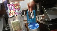 DipJar, located in six stores, is just one high-tech innovation seeking to make up for declining gratuities as people pay for small purchases with credit or debit cards. (CARLO ALLEGRI/REUTERS)