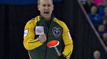 Northern Ontario skip Brad Jacobs reacts after his shot during their page playoff game against Newfoundland at the Canadian Men's Curling Championships in Edmonton, Alberta March 9, 2013. (ANDY CLARK/REUTERS)