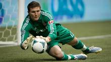Toronto FC goalkeeper Joe Bendik makes a save against the Vancouver Whitecaps during the first half of an MLS soccer game in Vancouver, B.C., on Saturday March 2, 2013. (DARRYL DYCK/THE CANADIAN PRESS)
