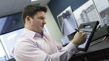 Nathan Belcher, FirstOnSite director of IT, has overseen the company's transition from paper records to digital. The move has saved the disaster restoration company time on its paperwork. (Adriano Valentini For The Globe and Mail)
