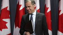 Mark Carney, the governor of The Bank of Canada, leaves a news conference in Ottawa, April 18, 2012. (PATRICK DOYLE/PATRICK DOYLE/REUTERS)