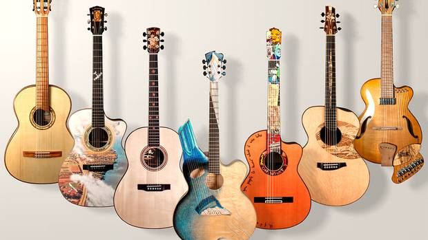 Each of the seven guitars above, on display at the McMichael Gallery, represents a different Group of Seven painter.