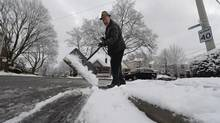 """In many parts of Toronto, """"property owners are required to clear snow from their sidewalks within 12 hours after a storm,"""" according to the city website. (Fred Lum/The Globe and Mail)"""