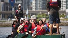 Dragon Boat coach Patrick Couling (left rear) steers during a practice session at False Creek in Vancouver. (Rafal Gerszak/Rafal Gerszak for The Globe and Mail)