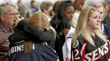 Mourners gather for Daron Richardson's memorial service at Scotiabank Place in Ottawa. (DAVE CHAN/Dave Chan for The Globe and Mail)