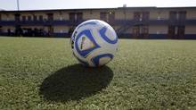 A soccer ball rests on an artificial turf soccer field. (AP Photo/Eric Gay) (Eric Gay/AP)