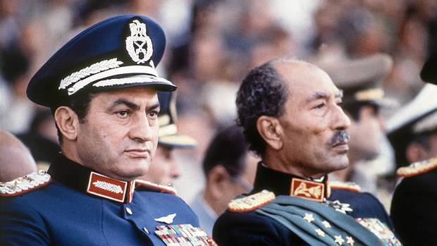 In this Oct. 6, 1981 file photo, Egyptian President Anwar Sadat, right, and Vice President Hosni Mubarak are seen on the reviewing stand during a military parade just before soldiers opened fire from a truck during the parade at the reviewing stand, killing Sadat and injuring Mubarak. More than a quarter-million people flooded Cairo's main square Tuesday, Feb. 1, 2011 in a stunning and jubilant array of young and old, urban poor and middle class professionals, mounting by far the largest protest yet in a week of unrelenting demands Mubarak to leave after nearly 30 years in power. (Bill Foley/AP/Bill Foley/AP)