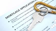 Photographer mortgage application form with house key. (iStockphoto/iStockphoto)