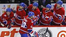Montreal Canadiens forward Maxim Lapierre celebrates his goal with team mates during the third period of play against the Washington Capitals in Game 6 of their NHL Eastern Conference quarter-final. (SHAUN BEST)