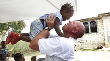 HMCS Halifax Petty Officer Andy Cotterill plays with Felicity, 2, at the Faith and Love in Action Orphanage in Jacmel, Haiti. Cotterill met the young girl at an orphanage the crew of the Halifax was working at in Jacmel following the earthquake. He fell in love with the little girl and wants to adopt her. (Deborah Baic/Deborah Baic/The Globe and Mail)