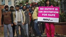 A demonstrator holds a placard during a protest outside a court in New Delhi Jan. 21, 2013. (ADNAN ABIDI/REUTERS)