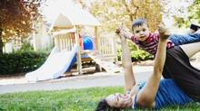 Unless you have photos like this in your scrapbook, you may not be taking your child to the park often enough. (Jupiterimages/Getty Images/Brand X)