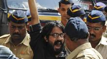 Cartoonist Aseem Trivedi shouts slogans as he is escorted by police outside a court in Mumbai on Monday. His arrest has revived a national debate on freedom of speech in the world's largest democracy, just weeks after Twitter became more restricted. (STRINGER/INDIA/REUTERS)