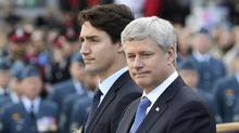 Justin Trudeau and Stephen Harper will both attend the funeral of Shimon Peres in Israel, but won't be flying there together. (CHRIS WATTIE/REUTERS)