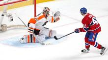 Montreal Canadiens centre Paul Byron (41) scores a goal against Philadelphia Flyers goalie Michal Neuvirth (30) during a shootout at Bell Centre. (Jean-Yves Ahern/USA Today Sports)